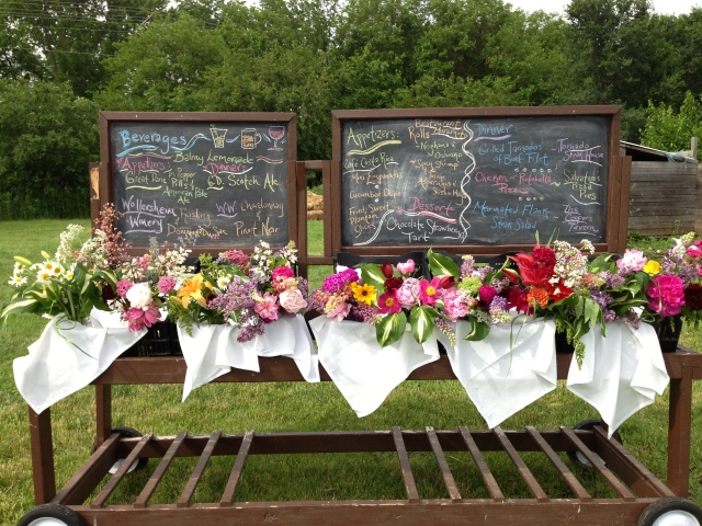 Menu board adorned with flowers