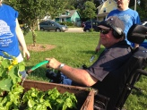 Steve watering his basil